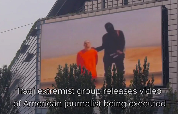 china-plays-isis-james-foley-execution-beheading-video-on-giant-outdoor-tv-obama