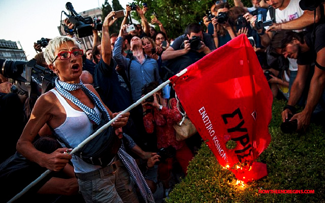syriza-party-flags-burn-in-greece-streets-alexis-tsipras-wont-resign