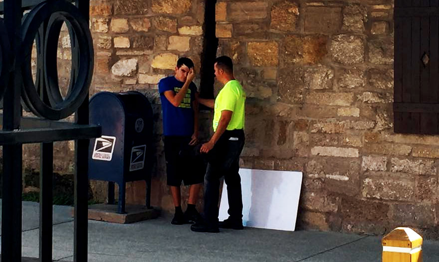 young-man-getting-saved-through-street-preaching-nteb-gospel-tracts-witnessing