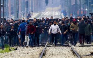 muslim-migrants-tear-down-fence-in-macendonia-greece-islam-terrorism-nteb