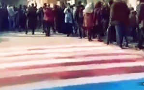 Iranian protesters in Tehran refuse to walk on US, Israeli flags