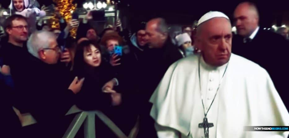 Pope Francis has apologized after slapping a woman's hand as he greeted pilgrims at the Vatican on New Year's Eve.