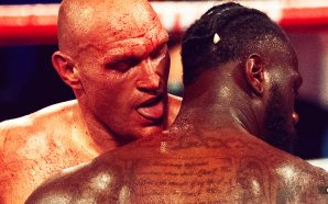Tyson Fury licks blood off Deontay Wilder's neck during WBC heavyweight boxing championship win Saturday night.
